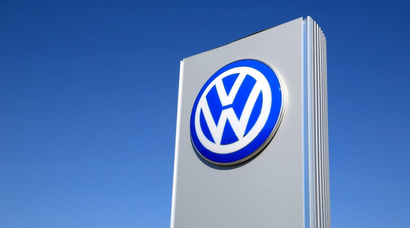 FORSSA, FINLAND - MAY 17, 2014: Sign Volkswagen against blue sky. The Volkswagen Group delivered over 9 million vehicles in period from January to November for the first time ever in 2014.