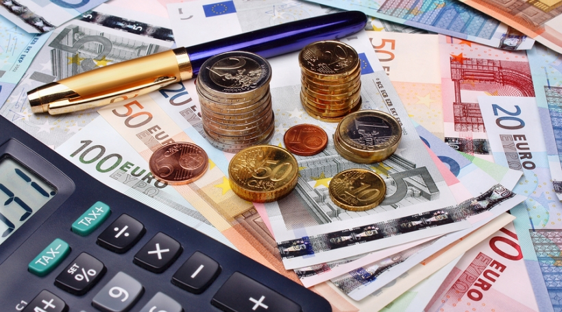 Euro money and calculator on money background