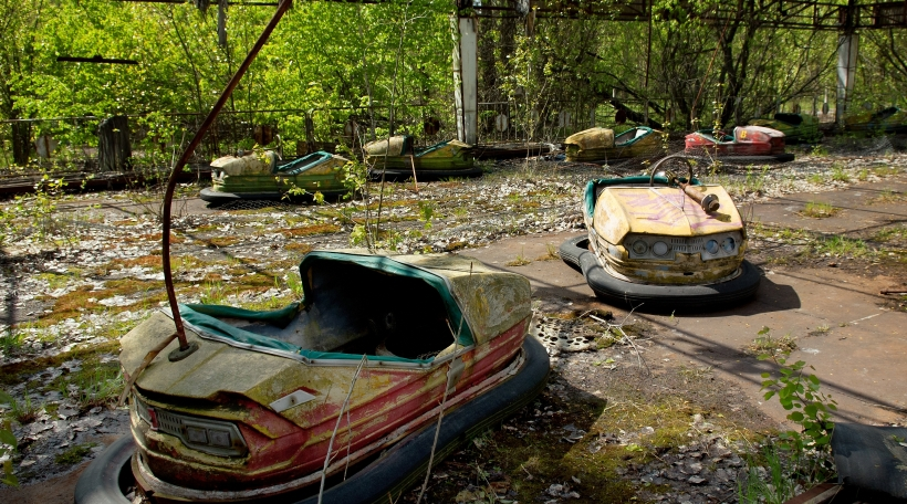 Bumper cars in abandoned amusement park in Pripyat town in Chernobyl Exclusion Zone, place of Chernobyl nuclear disaster in Ukraine at spring