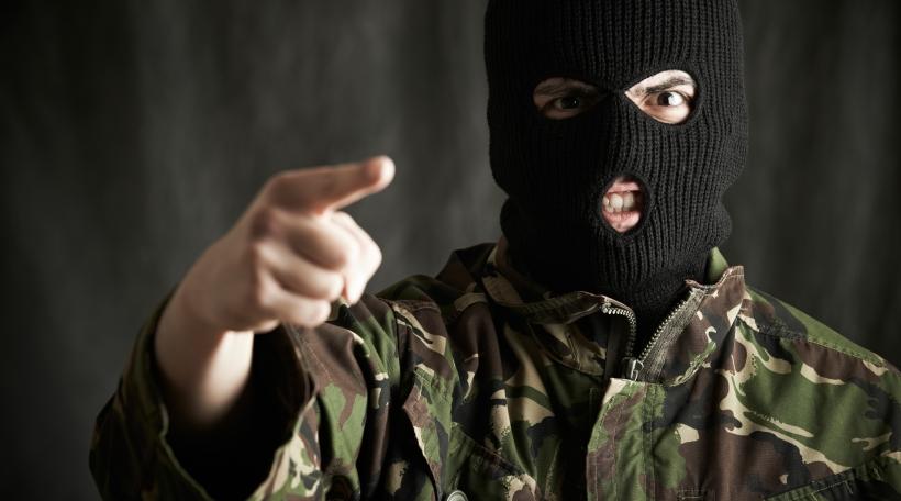 Portrait Of Threatening Terrorist Wearing Balaclava Addressing Camera