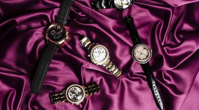 set of six jewelry watches on red silk