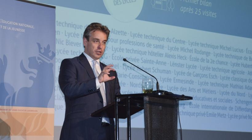 Den Educatiounsminister Claude Meisch zitt en Zwëschebilan no 25 Visitten (Foto: Educatiounsministère)