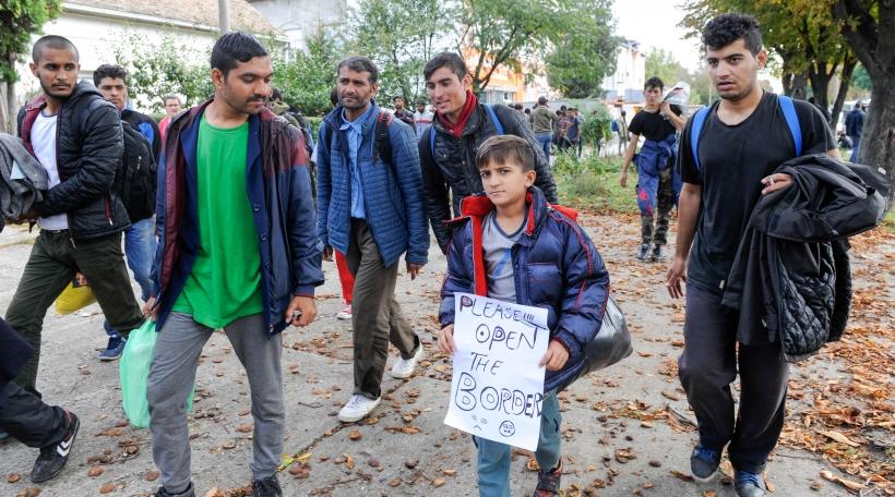 NOVA PAZOVA, SERBIA - CIRCA OCTOBER 2016: Migrants from Middle East walks to Hungarian border, circa October 2016 in Nova Pazova