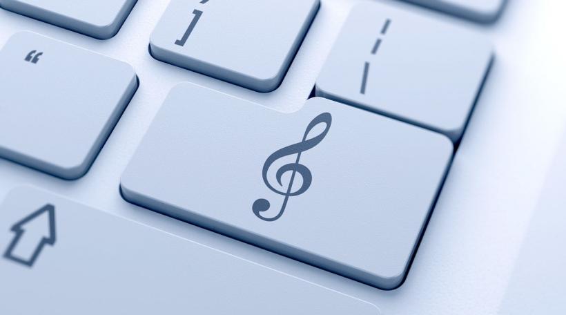 Solschlëssel op Tastatur