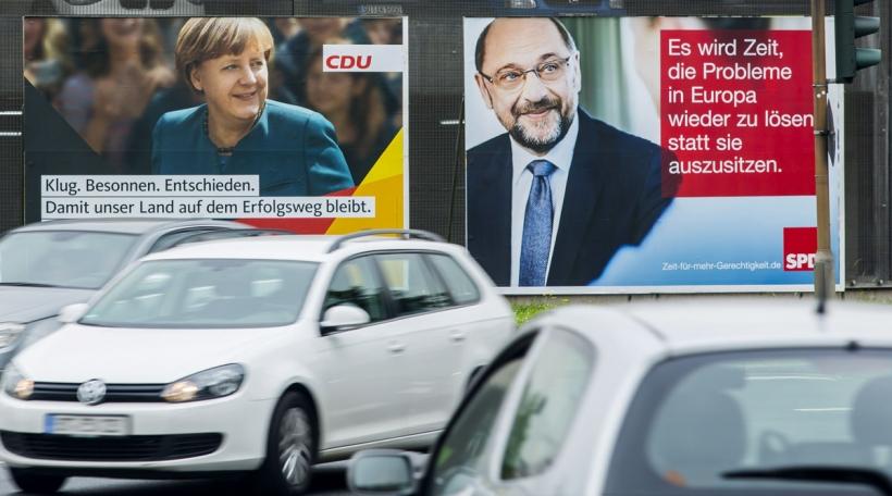Wahlplakater vu Merkel a Schulz