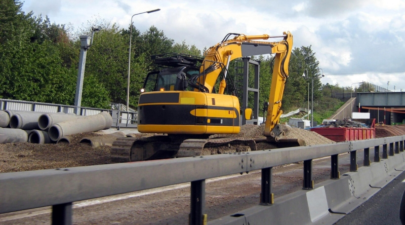 road works. road construction. construction in the motorway/highway.mechanical digger digging the ground